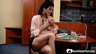 Sensational MILF teases while working at burnish apply office
