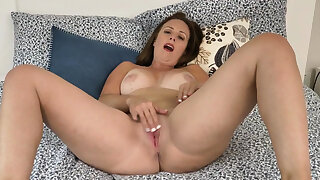 Canadian milf Brandii fingers her pussy to pink lingerie