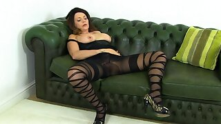 English mature Sophia puts dildo to work